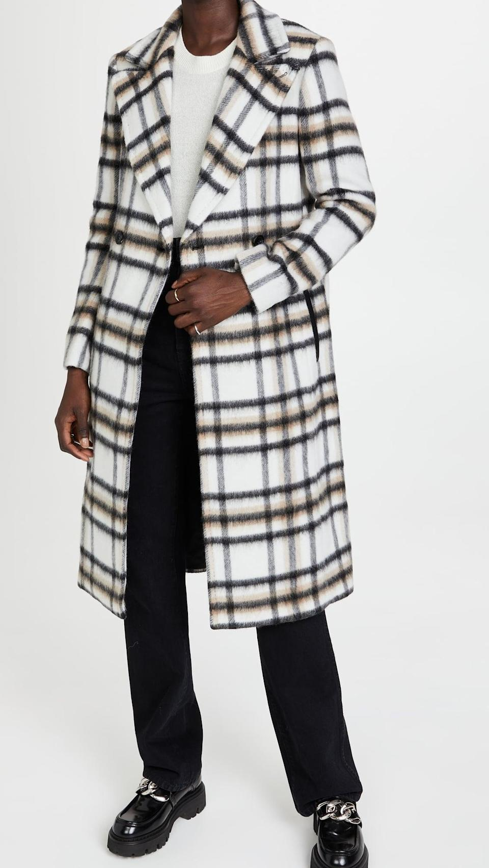 <p>This <span>Mackage Sienna-Pl Coat</span> ($950) is a cool take on neutrals. It also has a belt, but we love it undone.</p>