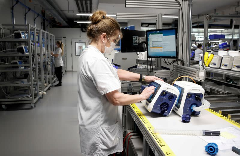 FILE PHOTO: Employees of Hamilton Medical AG test ventilators at a plant in Domat/Ems