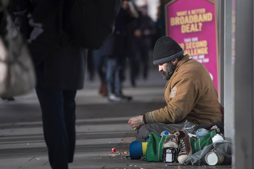 <p>On the same day that refugees receive their legal status, they are served with an eviction notice from the Home Office (file photo)</p> (PA)