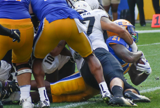 Pittsburgh running back A.J. Davis (21) gets into the end zone past Central Florida defensive lineman Mason Cholewa (97) for a touchdown during the first half of an NCAA college football game, Saturday, Sept. 21, 2019, in Pittsburgh. (AP Photo/Keith Srakocic)
