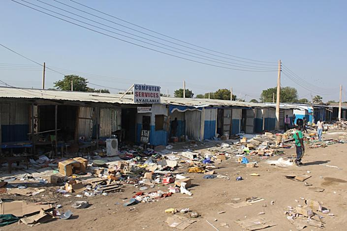 This December 25, 2013 photo shows the aftermath of massive looting conducted by rebels at a market in Bor, South Sudan (AFP Photo/Waakhe Simon Wudu)