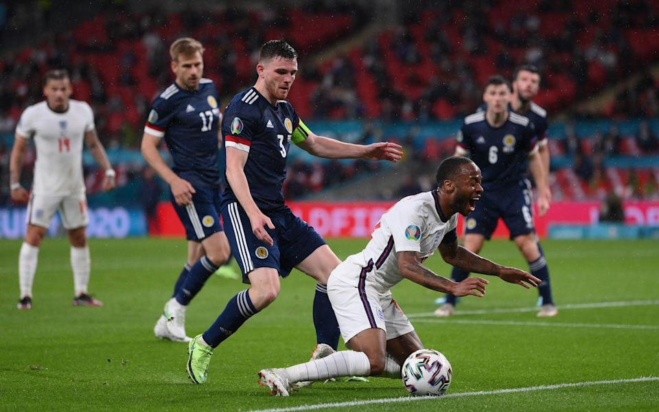 Raheem Sterling of England is challenged by Andrew Robertson - Getty Images
