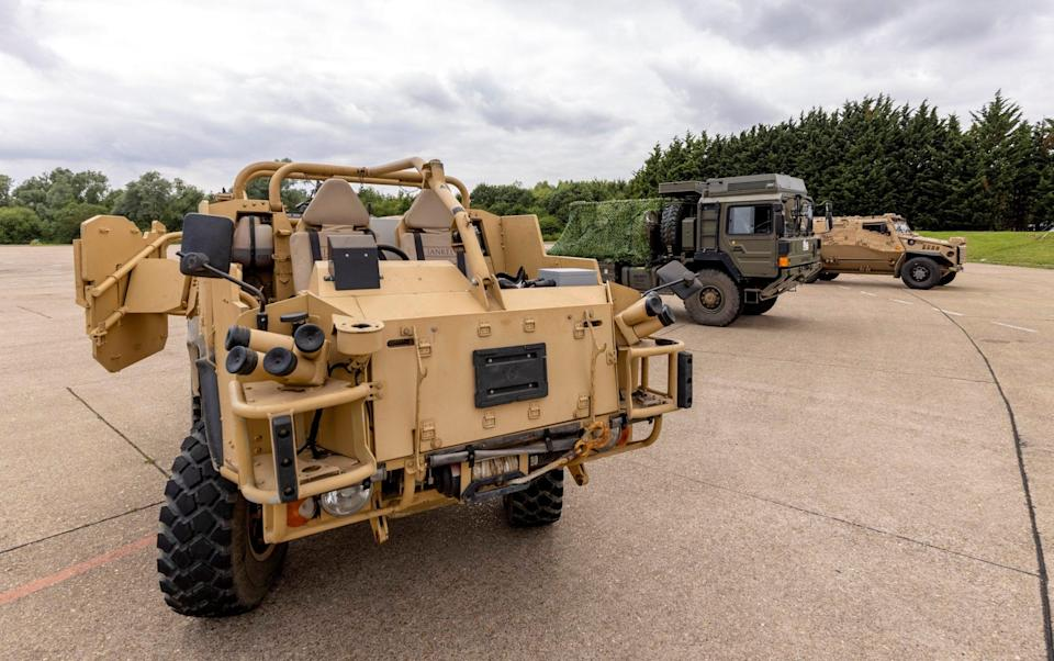 Hybrid experimental prototypes of the Army'€s Foxhound (rear), Jackal (front) and MAN SV vehicles - Sergeant Ben Beale