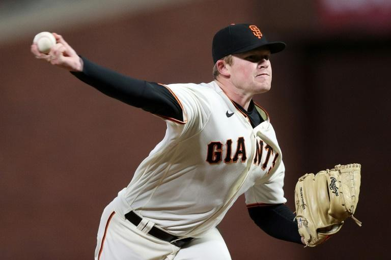 San Francisco Giants Logan Webb delivers a pitch against the Los Angeles Dodgers during the third inning of game one of the National League Division Series in San Francisco (AFP/EZRA SHAW)