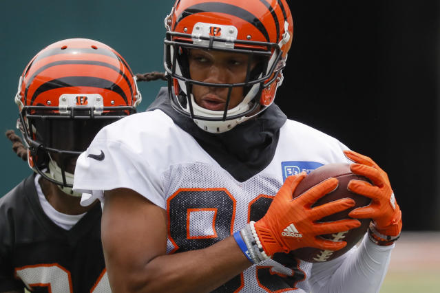 FILE - In this June 12, 2019 file photo Cincinnati Bengals wide receiver Tyler Boyd participates during practice at the team's NFL football facility in Cincinnati. Receiver Tyler Boyd signed a four-year contract extension on Tuesday, July 23, 2019 coming off his breakthrough season with the Cincinnati Bengals. (AP Photo/John Minchillo, File)