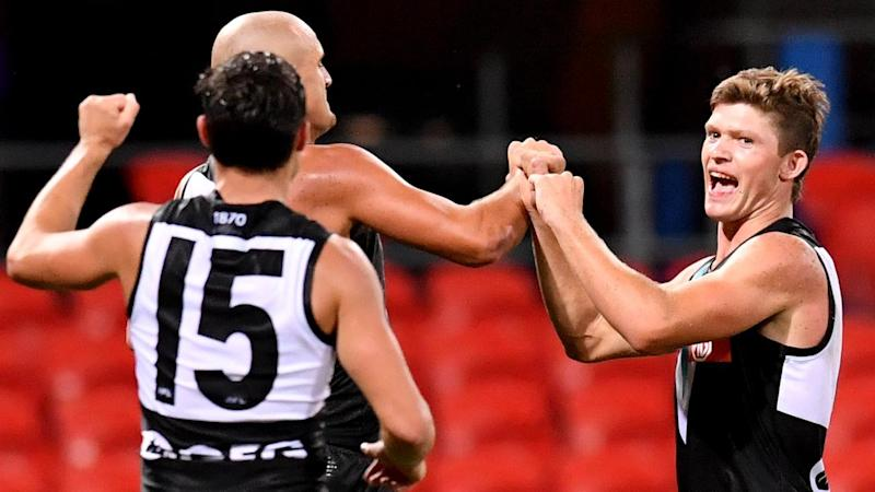 Mitch Georgiades (R) played a starring role in Port Adelaide's round one win over the Gold Coast