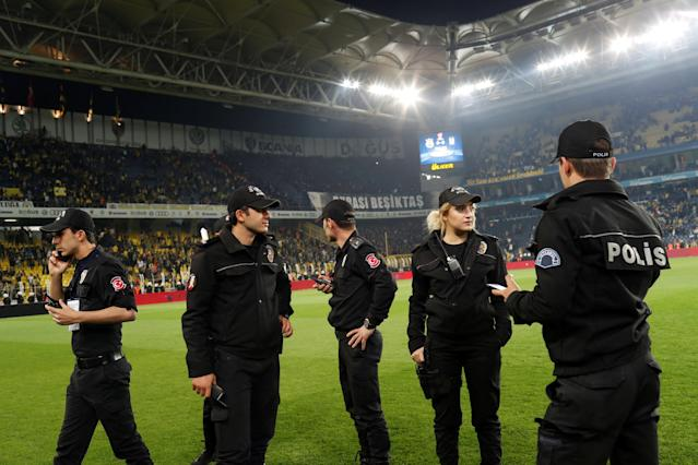 Soccer Football - Turkish Cup - Semi Final - Fenerbahce vs Besiktas - Sukru Saracoglu Stadium, Istanbul, Turkey - April 19, 2018 Police look on as the game is delayed REUTERS/Murad Sezer