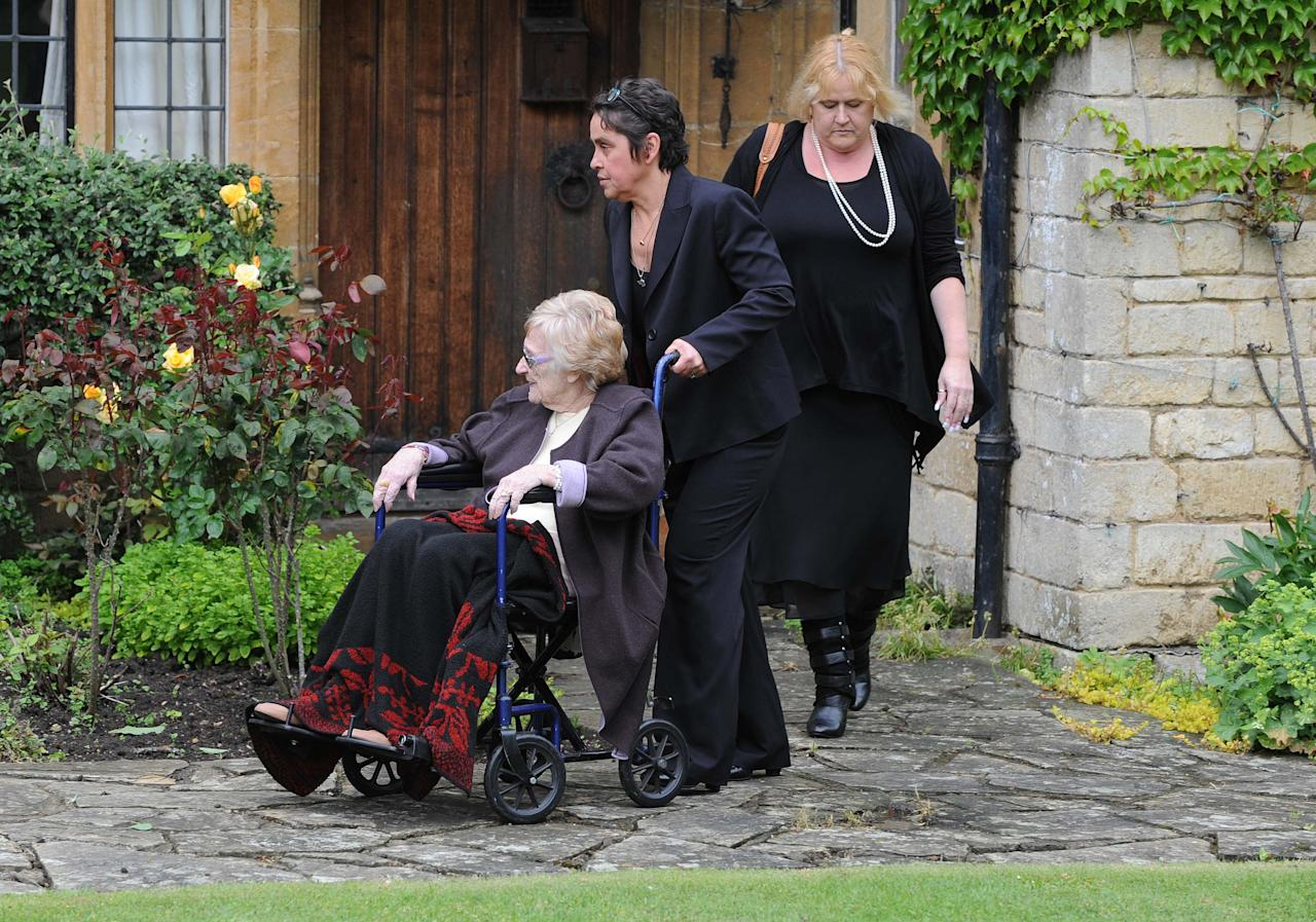 OXFORD, UNITED KINGDOM - JUNE 08: Robin Gibb's mother Barbara Gibb (L) arrives for Robin Gibb's funeral at Priest End, Thame on June 8, 2012 in Oxford, England. (Photo by Stuart Wilson/Getty Images)