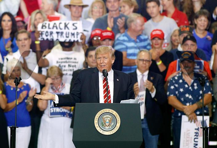 President Trump speaks to supporters at the Phoenix Convention Center during a rally on Aug. 22. (Photo: Ralph Freso/Getty Images)