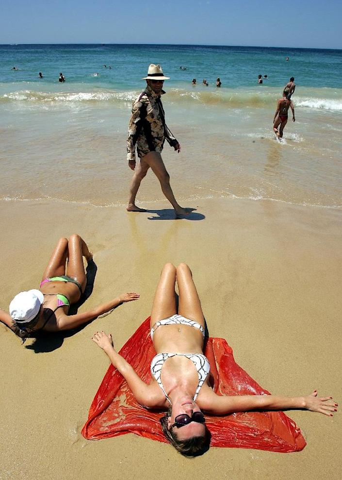 While debate continues as to how much of Australia's record skin cancer rate stems from depletion of UV-filtering ozone in the stratosphere, 30 years of public health campaigns have no doubt made Australians acutely aware of the dangers (AFP Photo/Torsten Blackwood)