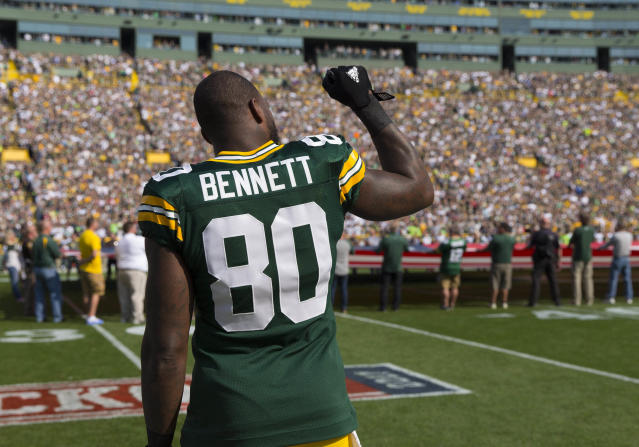 <p>Green Bay Packers tight end Martellus Bennett (80) holds his fist in the air during the national anthem prior to the game against the Seattle Seahawks at Lambeau Field. Mandatory Credit: Jeff Hanisch-USA TODAY Sports </p>