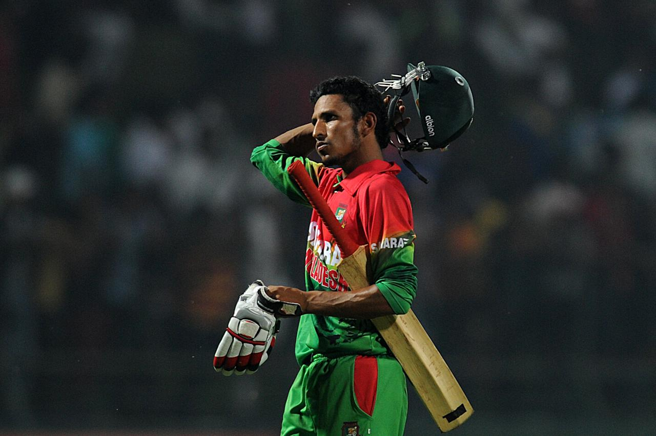 Bangladesh cricketer Nasir Hossain walks back to the pavilion after his dismissal during the Twenty20 International match between Sri Lanka and Bangladesh at The Pallekele International Cricket Stadium in Pallekele on March 31, 2013. AFP PHOTO/ Ishara S. KODIKARA
