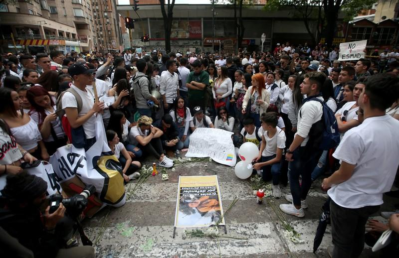 People gather in the street where Dilan Cruz was injured, allegedly by a tear gas canister fired by riot police during the national strike on the previous day, in Bogota