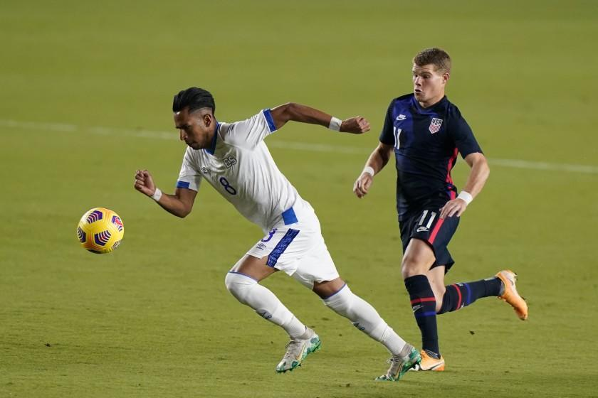 El Salvador midfielder Denis Pineda (8) and U.S forward Chris Mueller (11) battle for the ball, Wednesday, Dec. 9, 2020, during the first half of an international friendly match in Fort Lauderdale, Fla. (AP Photo/Wilfredo Lee)