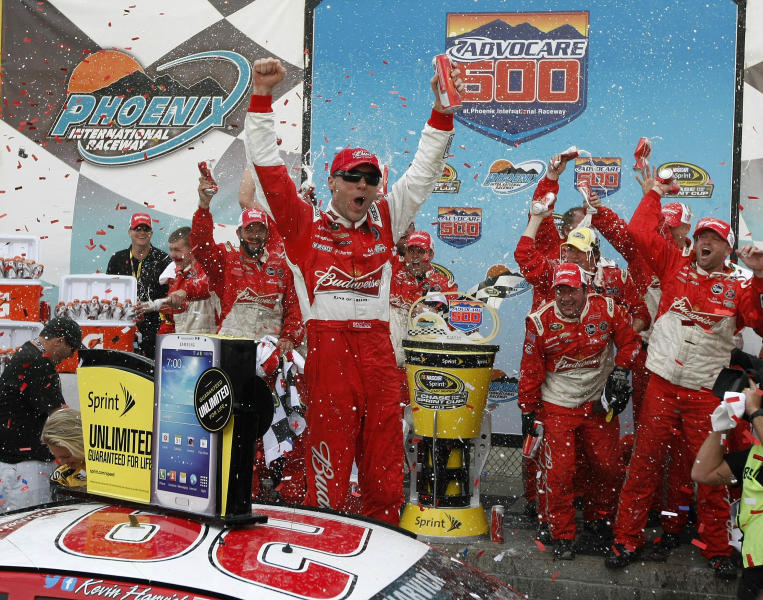 Kevin Harvick (29) celebrates in victory lane after winning the AdvoCare 500 NASCAR Sprint Cup Series auto race at Phoenix International Raceway, Sunday, Nov. 10, 2013, in Avondale, Ariz. (AP Photo/Ralph Freso)