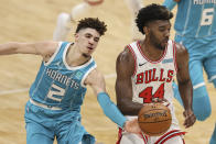 Charlotte Hornets guard LaMelo Ball (2) tries to knock the ball away from Chicago Bulls forward Patrick Williams (44) during the second half of an NBA basketball game in Charlotte, N.C., Thursday, May 6, 2021. (AP Photo/Nell Redmond)