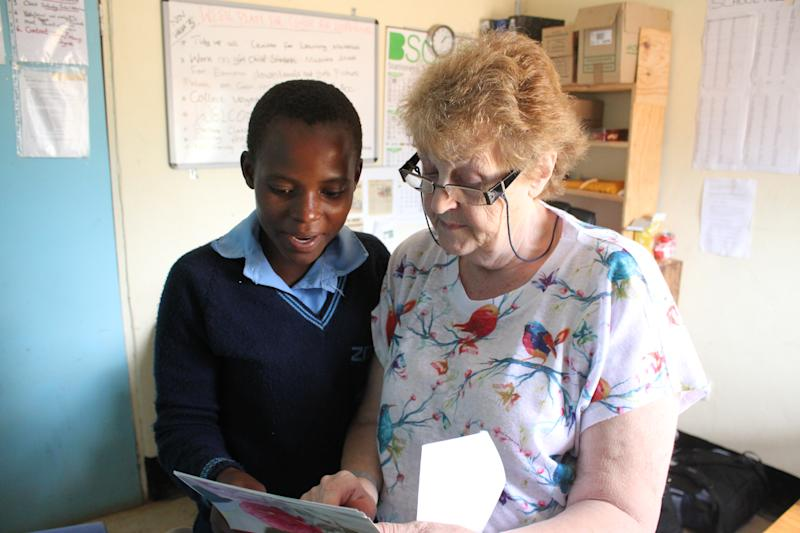 Mary Coyne works with a student in Malawi. (Wells for Zoë/Flickr)