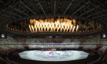 Fireworks are set off during the Paralympic Opening Ceremony over the Olympic Stadium for the Tokyo 2020 Paralympic Games, Tokyo, Tuesday, Aug. 24, 2021. (Bob Martin for OIS via AP)