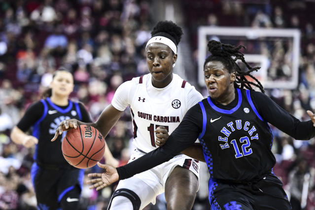 South Carolina forward Laeticia Amihere (15) dribbles the ball against Kentucky guard Amanda Paschal (12) during the second half of an NCAA college basketball game Thursday, Jan. 2, 2020, in Columbia, S.C. South Carolina defeated Kentucky 99-72.(AP Photo/Sean Rayford)
