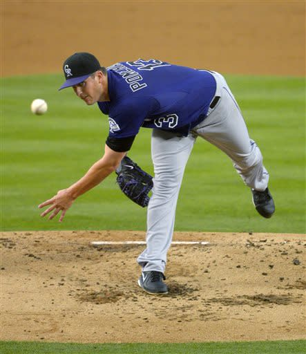 Colorado Rockies starting pitcher Drew Pomeranz throws to the plate during the second inning of the Rockies' baseball game against the Los Angeles Dodgers, Thursday, July 11, 2013, in Los Angeles. (AP Photo/Mark J. Terrill)