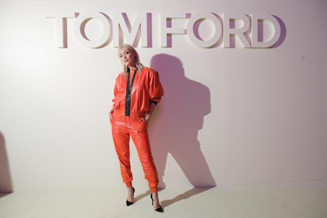 Pom Klementieff wears orange head-to-toe. (Photo: Courtesy of Tom Ford)