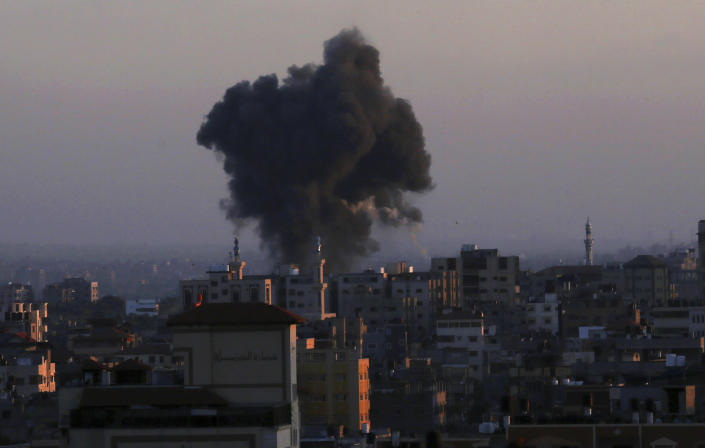 Smoke rises following Israeli airstrikes in Gaza City, Thursday, May 13, 2021. Weary Palestinians are somberly marking the end of the Muslim holy month of Ramadan, as Hamas and Israel traded more rockets and airstrikes and Jewish-Arab violence raged across Israel. (AP Photo/Adel Hana)