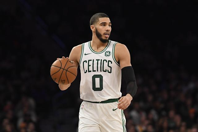 Boston Celtics forward Jayson Tatum (0) controls the ball during the second half of an NBA basketball game against the New York Knicks, Sunday, Dec. 1, 2019, in New York. (AP Photo/Sarah Stier)