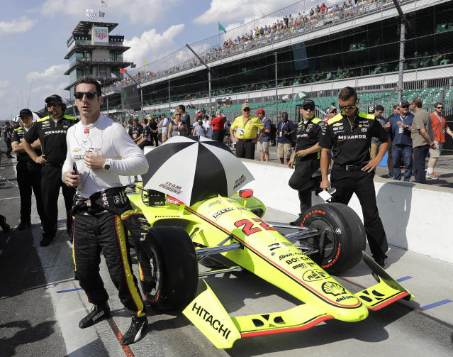 FILE - In this Sunday, May 20, 2018, file photo, Simon Pagenaud, front left, of France, waits during qualifications for the IndyCar Indianapolis 500 auto race at Indianapolis Motor Speedway in Indianapolis. Chevrolet engines have powered some of IndyCars biggest winners over the last six years. 2016 series champ Simon Pagenaud knows Chevrolet and Honda engines well. (AP Photo/Darron Cummings, File)