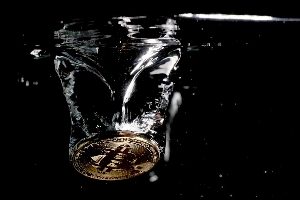 A visual representation of the digital currency Bitcoin sinks into water on August 15, 2018 in London, England.