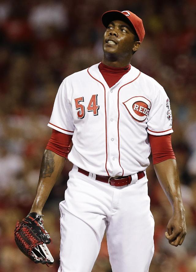 Cincinnati Reds relief pitcher Aroldis Chapman watches a solo home run by San Diego Padres' Chase Headley in the ninth inning of a baseball game, Tuesday, May 13, 2014, in Cincinnati. San Diego won 2-1. (AP Photo)