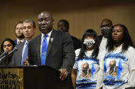Attorney Ben Crump speaks during a news conference surrounded by attorneys, supporters and family of Byron Williams, Thursday, July 15, 2021, in Las Vegas. The family of 50-year-old Williams, whose death in Las Vegas police custody after a bicycle chase in 2019 was ruled a homicide, is suing the city and four officers they accuse of wrongful death and civil rights violations. (AP Photo/John Locher)