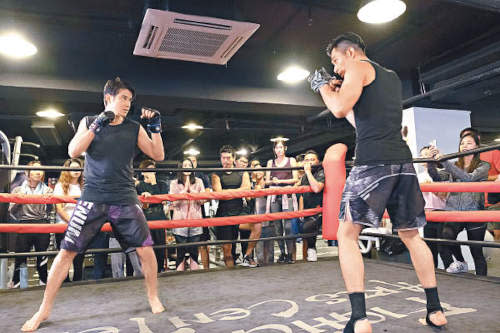 Mario films the boxing ring scene with Pakho Chau on his first day