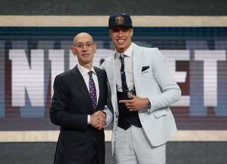 FILE PHOTO: Jun 21, 2018; Brooklyn, NY, USA; Michael Porter, Jr. (Missouri) greets NBA commissioner Adam Silver after being selected as the number fourteen overall pick to the Denver Nuggets in the first round of the 2018 NBA Draft at the Barclays Center. Mandatory Credit: Brad Penner-USA TODAY Sports