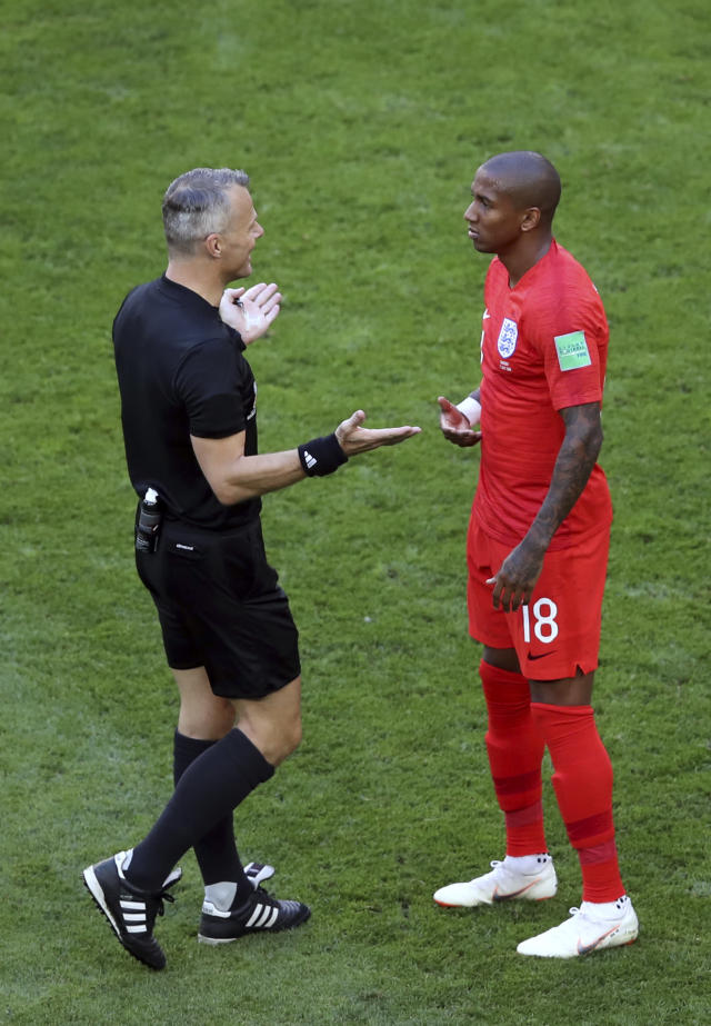 <p>Referee Bjorn Kuipers gestures to England's Ashley Young </p>