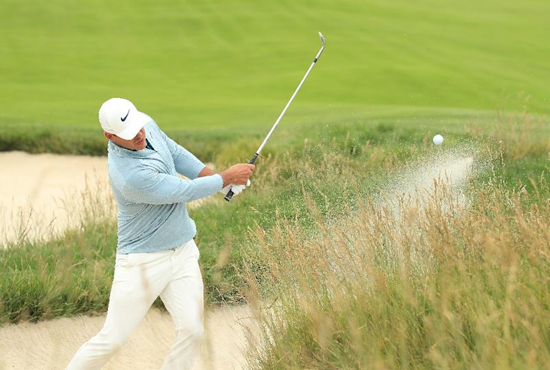 American Brooks Koepka plays a bunker shot in Sunday's final round of the US Open (AFP Photo/Andrew Redington)