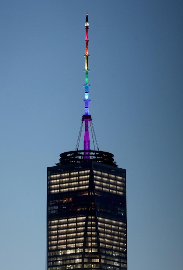 <p>One World Trade Center is lit up in the colors of the pride flag to honor the victims of the Orlando mass shooting, June 12, 2016. (Andrew Gombert/EPA) </p>