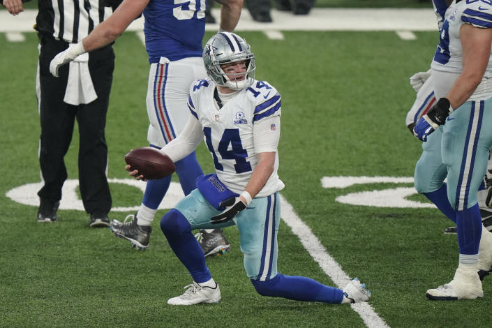 Dallas Cowboys quarterback Andy Dalton reacts after being sacked during the second half of an NFL football game against the New York Giants, Sunday, Jan. 3, 2021, in East Rutherford, N.J. (AP Photo/Corey Sipkin)
