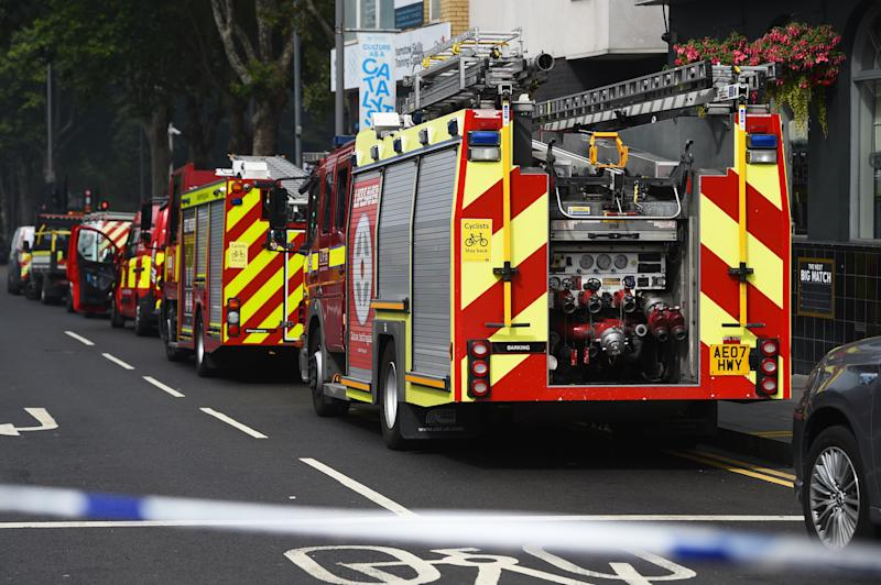 Fire engines at the scene of the fire at a shopping centre in east London (Picture: PA)