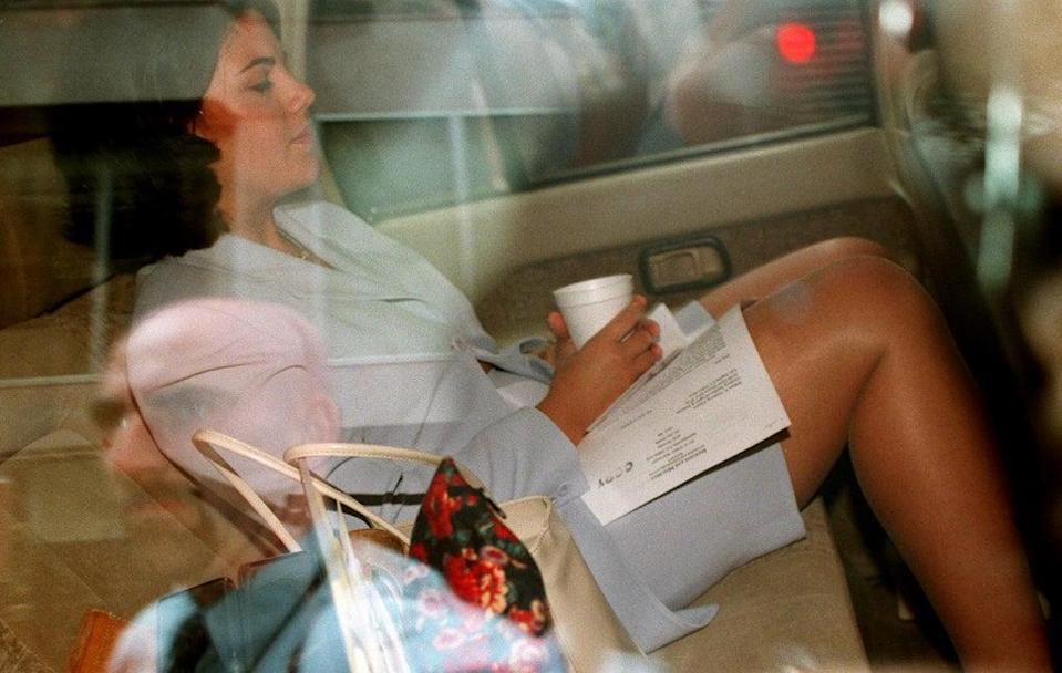 Monica Lewinsky is photographed through a window of a car on 28 July 1998 outside of her attorneys' office in Washington, DC (TIM SLOAN/AFP via Getty Images)