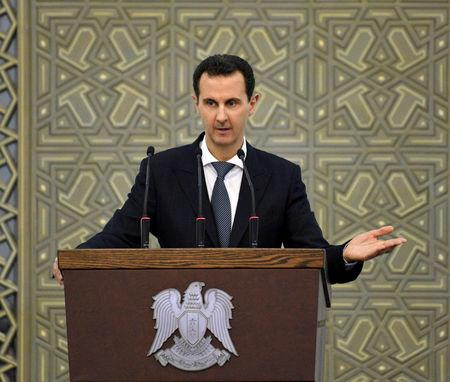 FILE PHOTO:  Syria's President Bashar al-Assad speaks during a meeting with heads of local councils, in Damascus