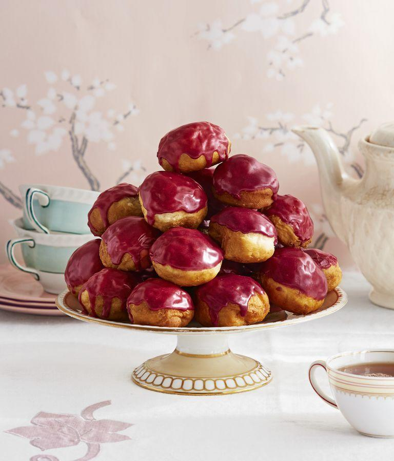 "<p>Everyone will love diving into these homemade donuts for dessert. </p><p><strong><a href=""https://www.countryliving.com/food-drinks/a26868735/rooibos-blueberry-glazed-donut-holes-recipe/"" rel=""nofollow noopener"" target=""_blank"" data-ylk=""slk:Get the recipe"" class=""link rapid-noclick-resp"">Get the recipe</a>.</strong></p>"