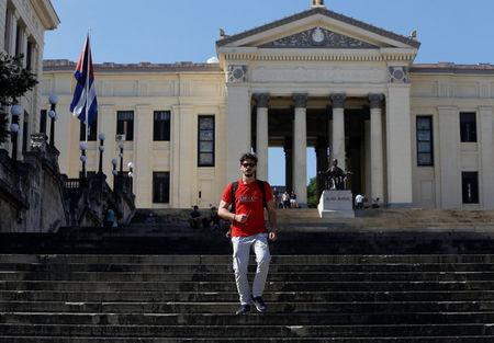 Miguel Hayes, who writes for the blog La Joven Cuba, walks down the staircase of the University of Havana, in Havana, Cuba February 5, 2018. REUTERS/Stringer