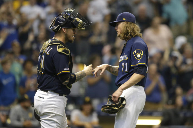 Milwaukee Brewers' Josh Hader is congratulated by Yasmani Grandal after recording a save during the ninth inning of a baseball game against the Pittsburgh Pirates, Sunday, Sept. 22, 2019, in Milwaukee. (AP Photo/Aaron Gash)