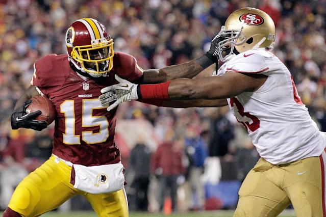 Washington Redskins wide receiver Josh Morgan pushes San Francisco 49ers defensive end Tony Jerod-Eddie during the first half of an NFL football game in Landover, Md., Monday, Nov. 25, 2013. (AP Photo/Mark Tenally)