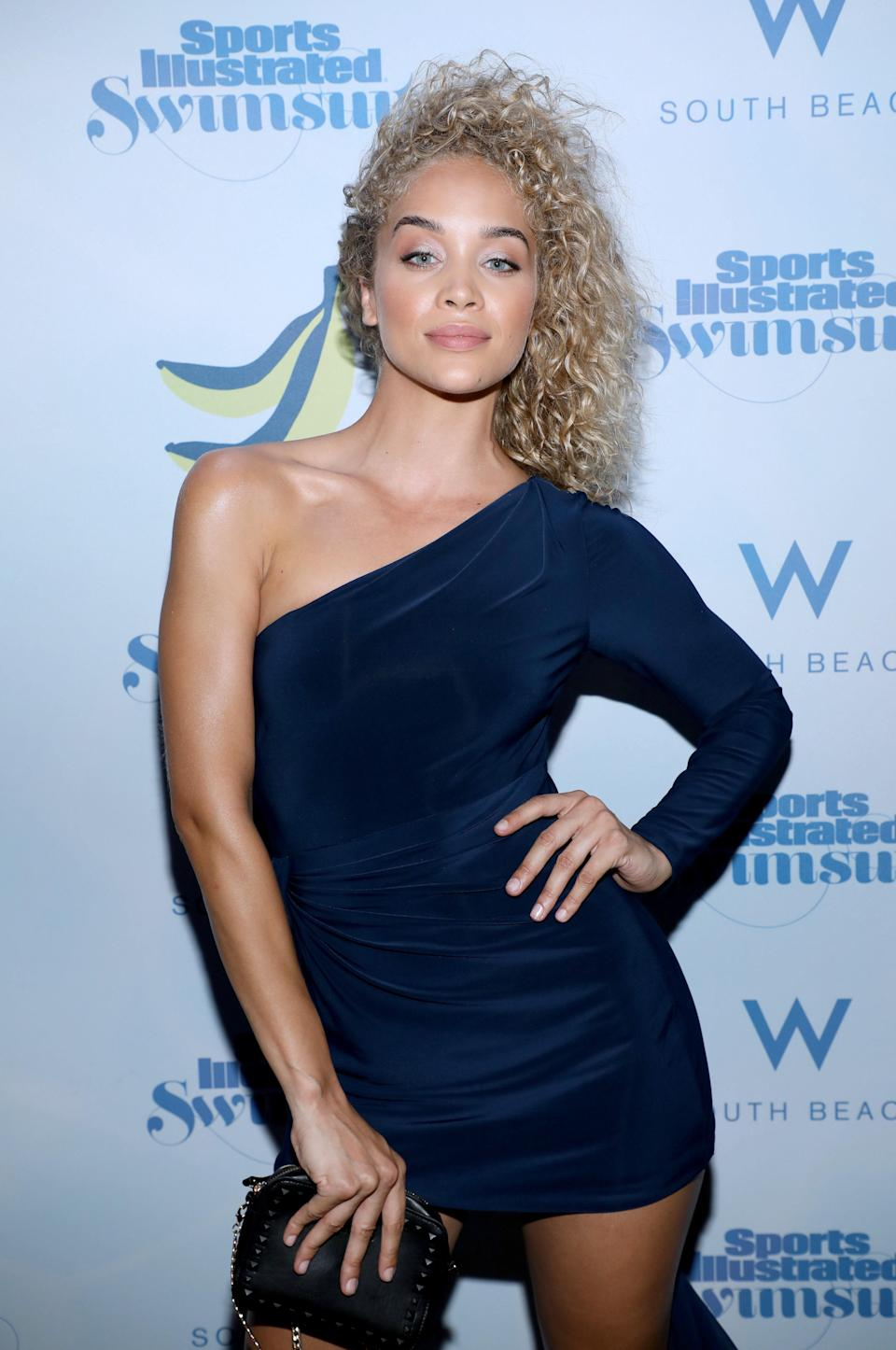 Ashy blond doesn't have to be superlight, as demonstrated by model Jasmine Sanders. The cooler shade looks amazing with her natural curls.