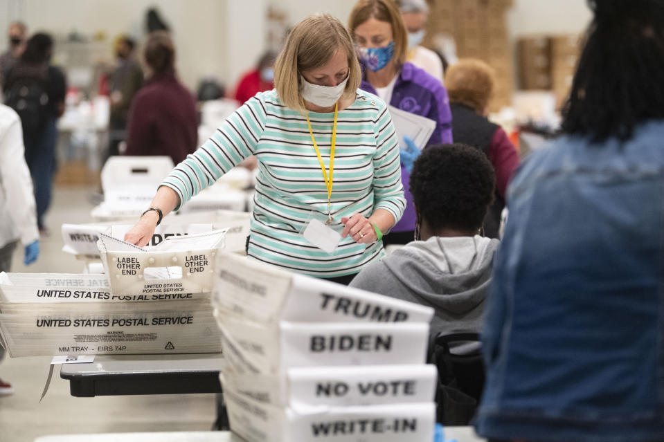An election worker sorts through ballots during a Cobb County hand recount of Presidential votes on Sunday, Nov. 15, 2020, in Marietta, Ga. (John Amis/Atlanta Journal & Constitution via AP)