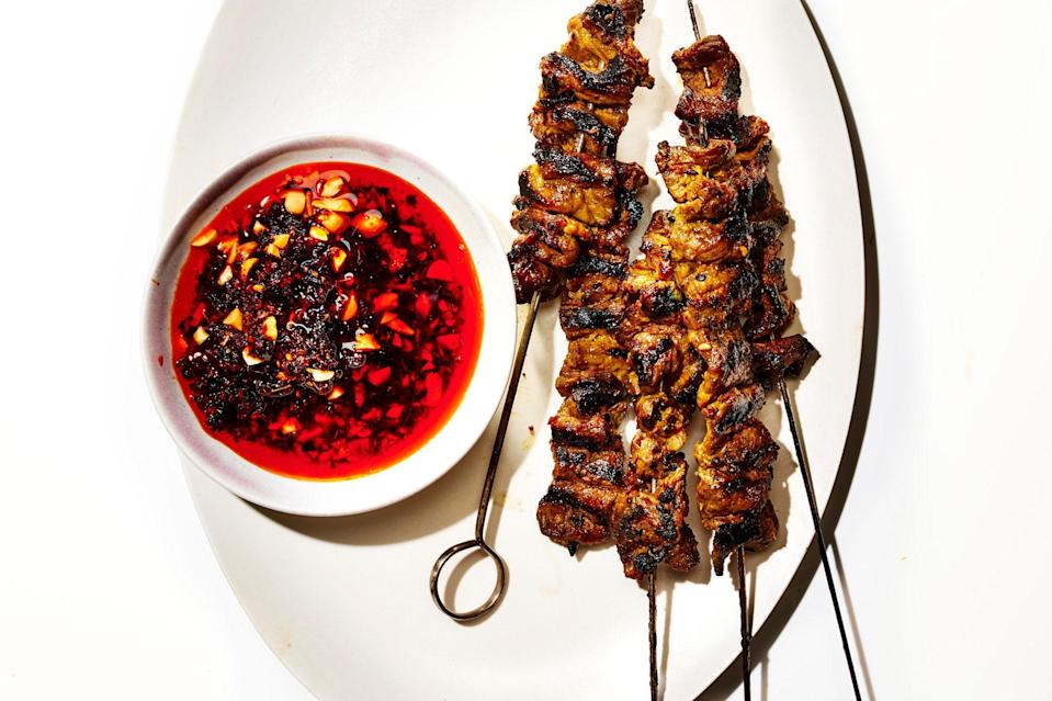 """Braising gets all the glory, but there's <a href=""""https://www.epicurious.com/ingredients/our-best-beef-short-rib-recipes-braised-grilled-roasted-tacos-stew-kebabs-gallery?mbid=synd_yahoo_rss"""" rel=""""nofollow noopener"""" target=""""_blank"""" data-ylk=""""slk:more than one way to cook short ribs"""" class=""""link rapid-noclick-resp"""">more than one way to cook short ribs</a>. The gorgeous marbling encourages crispy bits when these kebabs hit the open flame, and the umami-forward marinade—redolent of lemongrass, garlic and ginger, and fish sauce—is one you'll find yourself returning to. <a href=""""https://www.epicurious.com/recipes/food/views/coconut-marinated-short-rib-kebabs-with-peanut-chile-oil?mbid=synd_yahoo_rss"""" rel=""""nofollow noopener"""" target=""""_blank"""" data-ylk=""""slk:See recipe."""" class=""""link rapid-noclick-resp"""">See recipe.</a>"""