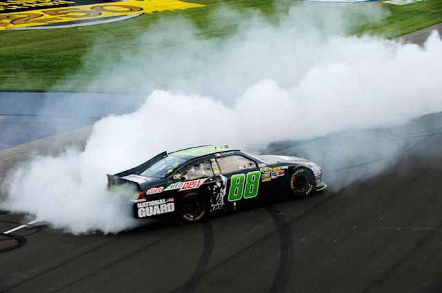 BROOKLYN, MI - JUNE 17: Dale Earnhardt Jr., driver of the #88 Diet Mountain Dew/TheDarkKnightRises/National Guard/ Chevrolet, celebrates winning the NASCAR Sprint Cup Series Quicken Loans 400 with a burnout at Michigan International Speedway on June 17, 2012 in Brooklyn, Michigan. (Photo by Jared C. Tilton/Getty Images)