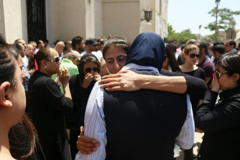 Relatives and friends of passengers of the EgyptAir plane that crashed in the Mediterranean comfort each other during prayers at Abou Bakr el-Sedek mosque in Cairo