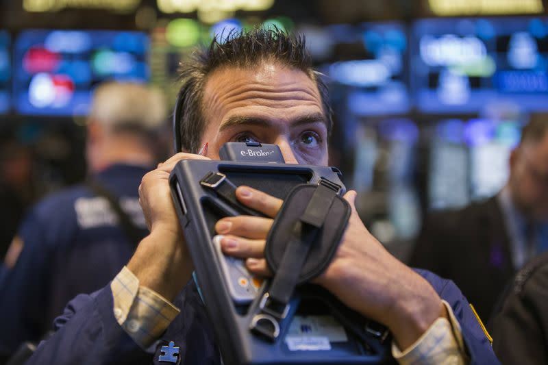 A trader works on the floor of the New York Stock Exchange shortly after the markets opened, in New York